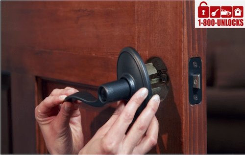 dark lever lock getting installed on a wooden door