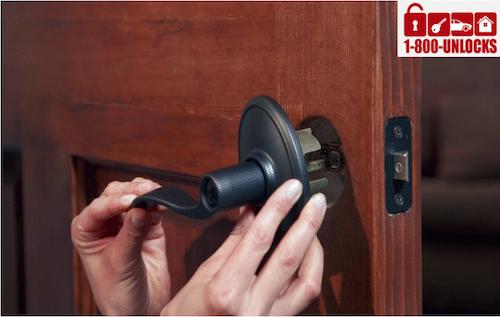 dark lever lock getting installed on a wooden door