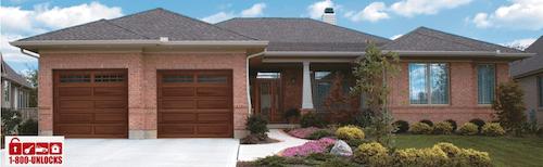 brick house with garage doors